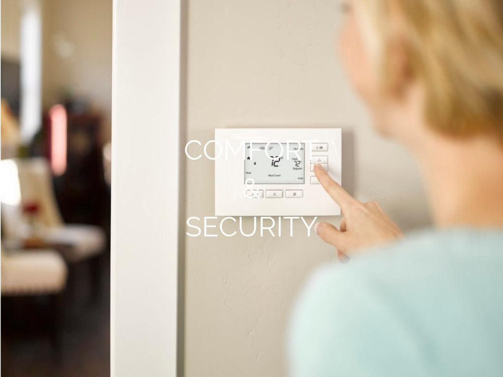 """Smart home automation panel with """"Comfort & Security"""" text overlay"""
